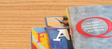 Books arranged to form the acronym FAQ